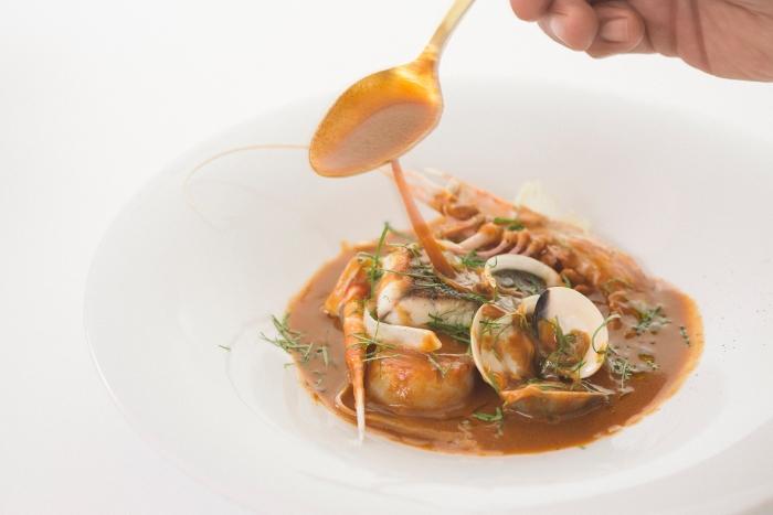 Bouillabaisse soup, scampi, clams, hokkaido scallops, seabass, aioli