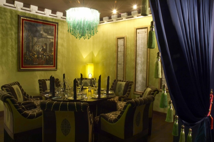 private party venue with chandelier and painting on the wall