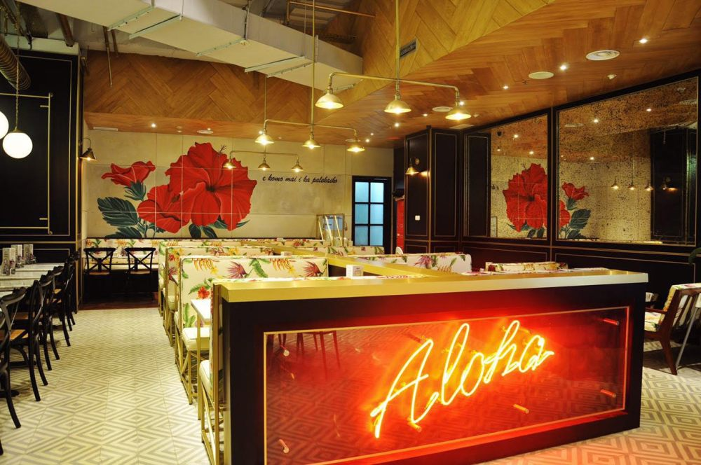 hawaian interior with aloha neon sign