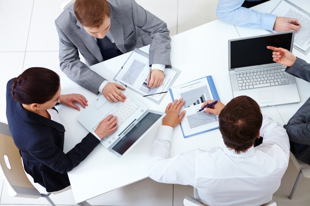 top-view-of-co-workers-planning-a-strategy_1098-2959